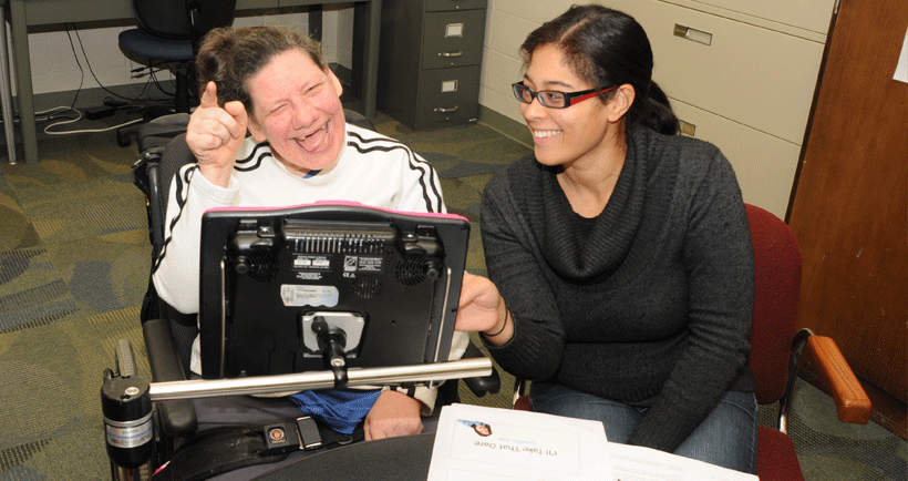 Woman with AAC device